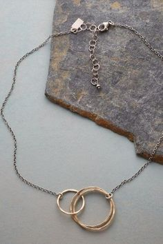 Revolutions Necklace Chic and versatile, this golden rings and sterling links ne. Jewelry Necklaces, Necklace Charm, Bracelets, Revolutions, Golden Ring, Delicate Jewelry, Oxidized Sterling Silver, Gifts For Mom, Jewelry Accessories