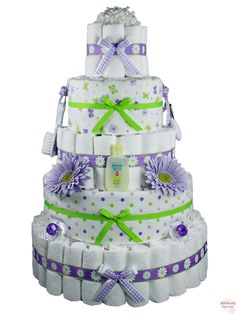 Pretty Purple Diaper Cake ~ My diaper cakes are typically only 3 layers. I also to wrap all my layers with either a fleece blanket or a receiving blanket. This website is nice because you have the option to zoom in and really see what is included in this diaper cake.