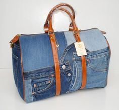 Denim duffle with leather trim.                                                                                                                                                                                 More