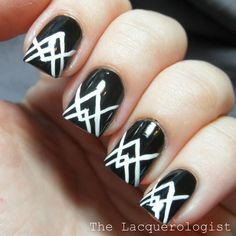 These white graphic tips make the perfect accent for bold black nails. This look from The Lacquerologist is pretty simple to re-create: Round up a black base coat, white polish, and a thin nail art brush to copy this angled nail art.
