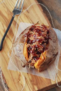 Pulled Pork Stuffed Sweet Potato - great way to eat bbq without bread! *We have been trying to eat healthier.errr we have been on a diet and this was GREAT reguardless! I would totally have this again. We used the leftover pulled pork in burritos later Pork Recipes, Slow Cooker Recipes, Real Food Recipes, Cooking Recipes, Yummy Food, Potato Recipes, Crockpot Recipes, Delicious Desserts, Gastronomia
