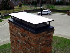 simple black chimney cap, flat and low profile.