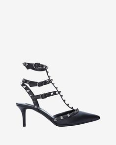 Valentino Noir Rockstud Slingback Pump: Black: Hallmark the house of Valentino with a T strap front cage pump. Adding edgy appeal to your look through the cage styled double straps with tone on tone leather. The pointy toe leads to double T straps connecting to the adjustable buckled ankle strap at ...