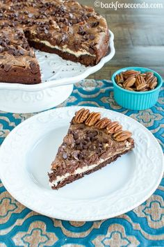 Chocolate Pecan Pie Brownie Cheesecake is the ultimate dessert! Perfect for serving at Thanksgiving or Christmas. It's really easy to make and so impressive!