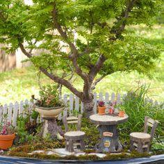 Plow & Hearth's Tree Stump Fairy Garden furniture in miniature gardens.