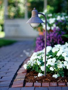 It Safe Well-lit garden paths are safer to walk on. Low-voltage lighting and solar landscape lights add style as well.Keep It Safe Well-lit garden paths are safer to walk on. Low-voltage lighting and solar landscape lights add style as well. Garden Tools, Magical Garden, Garden Paths, Landscape Design, Landscape Lighting Design, Outdoor Gardens, Walkway Design, Garden Path Lighting, Solar Landscape Lighting