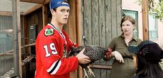 "Jonathan Toews with a Chicken -- He's like, ""I dunno why this is happening. But whatever. Let's roll with it."" And she doesnt trust him with the chicken either. Lmao"