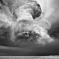 Awe-Inspiring swirling Superstorms belie their destructive power: Each summer photographer Mitch Dobrowner & guide Roger Hill drive through the Great Plains of the United States in search of these jaw-dropping forces of nature. When they find them, Dobrowner pulls out his camera & takes breathtaking black & white photos that capture the enormity & intensity of these churning atmospheric formations http://www.mitchdobrowner.com/ http://www.silverliningtours.com/Home/tabid/36/Default.aspx