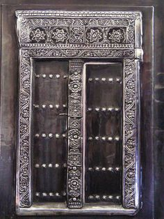 framed Zanzibar carved door worked in pewter sheet by Mary Ann Lingenfelder. Mimmic Gallery and Studio.  Worked with deep high relief and attention to fine pattern detail replicating the beautiful wooden doors carved by Zanzibar craftsmen.