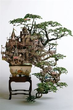 The Japanese artist Takanori Aiba created worlds in miniature bonsai trees, using materials such as craft paper, plastic and acrylic resin. Above, a castle around the small tree to its lowest branch.