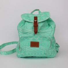 Victoria's Secret PINK Mint Mini Backpack Victoria's Secret PINK mint colored mini canvas backpack. Faint tribal pattern. Drawstring top with leather and metal magnetic snap closure on top. Great condition. Straps are adjustable. PINK Victoria's Secret Bags Backpacks