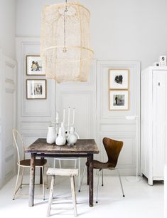 Maison Hand - Réalisation studio 35 m2 Lyon Saint Georges. Love the use of wooden doors in differing sizes for paneling.