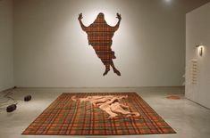 Grid Buster by Lynn Aldrich - 'From a bad taste decorator den carpet in a modernist grid erupts this (...) image of Jesus. I like the feeling that a powerful, supernatural event could happen in anybody's rec room… Christ rising from the grave of suburban melancholia.' It is significant that the glorified Jesus is covered with the pattern of the plaid, that seems to represent earthly reality. By becoming human like us, in his death he took upon himself the sick and sinful patterns of human…