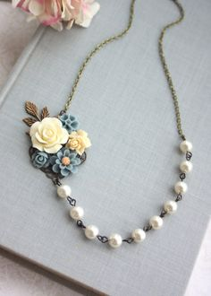 Pretty Ivory and Dusty Blue Collage Floral and Swarovski Ivory Pearls necklace.