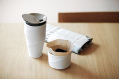 The beautiful and elegant Wave Coffee Tumbler not only looks good, it was ergonomically designed to be held easily with the simple and flowing curve outline. The mug is made out of double walled porcelain to help you keep your favorite beverage well insulated and warm for longer. It also features an advanced stainless steel sliding lid, and comes with a drip filter holder that fits perfectly on top, allowing you to also make your own coffee on the go.