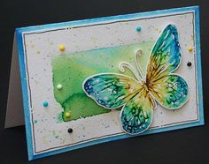 Deze stempel van de vlinder is erg geschikt om af te drukken met ecoline brushpennen. Ook de achtergrond is gemaakt met ecoline brushpennen.
