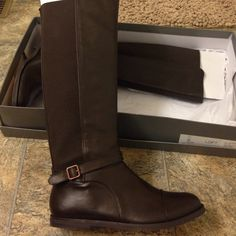 Brand new Loft brown boots!! Brand new dark brown riding boots from Loft. They have never been woren or even taken out of the box . Size 8.5 . They are pull on style with a stretchy material around calf . Great boots !!! LOFT Shoes