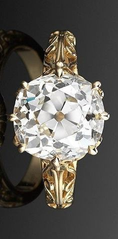 An old mine diamond filigree solitaire ring by Fred Leighton is set in 18-karat yellow gold.