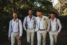 Braces have never looked so good! This groom and his groomsmen are looking fine in their crisp whites and natural linen suits PC: Margan Photography #whiteweddingsuits