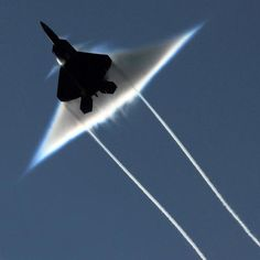 This U.S. Air Force F-22 Raptor was going supersonic as it dashed past the aircraft carrier USS John C. Stennis in the Gulf of Alaska. June 2009.