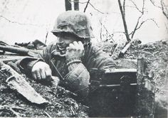 A soldier using a field telephone.