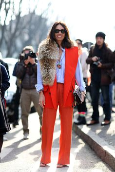 The European Guide To Flawless Style #refinery29 http://www.refinery29.com/milan-fashion-week#slide14 Viviana Volpicella stuns in red. Chop the sleeves off a power suit for a more modern silhouette.