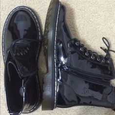 Patent leather black boots Shiny black material, never worn, not sure if genuine leather. Good for rain/snow. Very similar to Dr Martens Shoes Combat & Moto Boots
