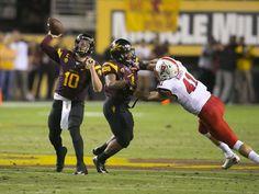 ASU quarterback Taylor Kelly passes as Utah linebacker