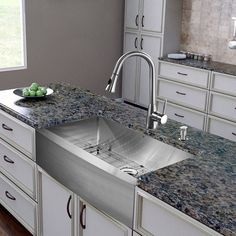 This inviting apron-front stainless steel Vigo single-bowl sink features a commercial-grade scratch resistant satin finish, dual-function pull-out spray head, retractable 360-degree swivel spout, and curved corners with rear standard drain placement.