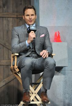 The slimmed down actor looked sharp as he made an appearance on the Jurassic World press tour at the Beijing, China Yintai Centre on Tuesday, after telling fans that he may embarrass himself. Actor Chris Pratt, Tight Suit, Hunks Men, Hottest Male Celebrities, Suit And Tie, Jurassic World, American Actors, Mens Suits, Sexy Men