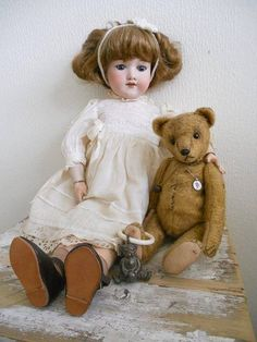 Antique Teddy Bear ...with an antique Doll and antique teething ring.