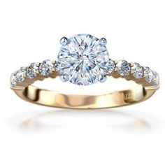 yellow gold engagement rings... Absolutely stunning! Solitaire diamonds accompanied by diamonds along the band.