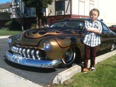 Little kid and his hot rod