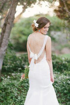 custom designed wedding gown with pearls and bows #weddinggown #bride #weddingchicks http://www.weddingchicks.com/2014/04/08/sweet-southern-love-wedding/