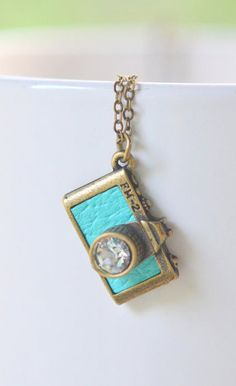 Turquoise Camera Charm Necklace in Antique Brass. This would be perfect for a friend of mine!