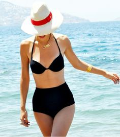 @Who What Wear - This sunbathing season, update your swimwear collection with one of our favorite classic black swimsuits. From triangle top bikinis to sleek one-piece suits, shop our amazing selection of noir swimsuits that are sure to make you want to have some fun in the sun!