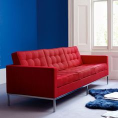 Red couch blue walls