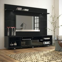 The Cabrini TV Stand and Cabrini Panel combined create a complete Home Theater Entertainment Center! Easily maneuver the Cabrini TV Stand 2.2 into place, with t