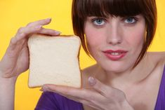 Stock Photos No One Would Ever Use: A woman showing off her prized piece of bread, first-place winner at the Dutchess County Fair:
