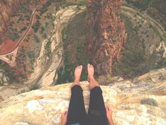 Sitting on the edge of a cliff. Long way down.