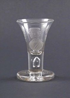 Edit     Delete  A Jacobite portrait firing glass c.1740, the trumpet bowl rising from a short teardrop stem and engraved with the head and shoulders of Bonnie Prince Charlie #glass