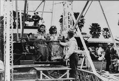 While the landing platforms for Ferris Wheels are a little bigger these days, seeing two smiling girls debark from the ride just like these two, photographed by Arthur Rothstein in1942, is something that won't take you long to spot at a modern county fair.    Read the full text here: http://www.mentalfloss.com/blogs/archives/117649#ixzz1tSlGmlr0   --brought to you by mental_floss!