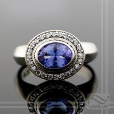 Tanzanite and Diamond Halo Ring - 14k white gold