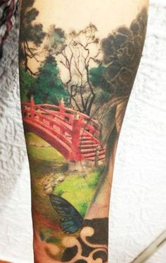 Joshua Gomez, Fabulous landscape with bridge, butterfly tattoo