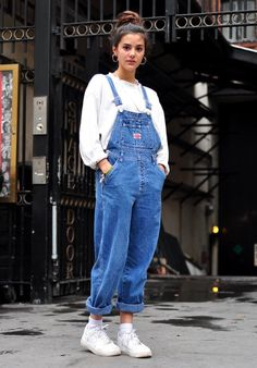 Denim overalls, hoops, and a top knot.