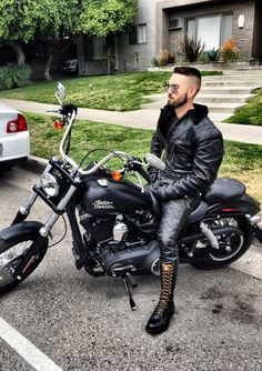 Leather biker having a Marlboro