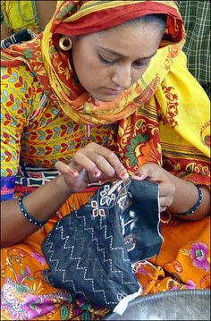 Economics: This is a girl making something that can be used for clothing that can be sold. Textile, Retail, Tourism and Mining are the leading money makers in the economic world in India. India mostly exports items to the United States. Also, it exports $309,100,000,000 in items a year.