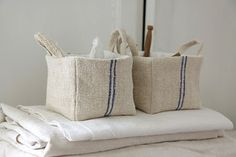 fabric baskets...  http://moderncountry.blogspot.com/search?updated-max=2011-05-23T14:07:00%2B02:00&max-results=20