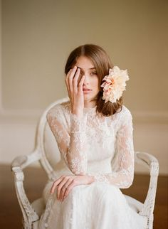 Maybe not long sleeves, but capped sleeves. Lace flower wedding dress