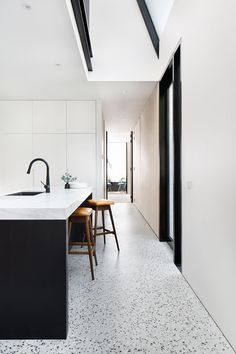 A black and white kitchen with matt polished concrete floors Photography by Emily Bartlett Polished Concrete Kitchen, Concrete Kitchen Floor, Polished Concrete Flooring, Terrazzo Flooring, White Concrete, Kitchen Flooring, Home Decor Kitchen, Kitchen Interior, New Kitchen